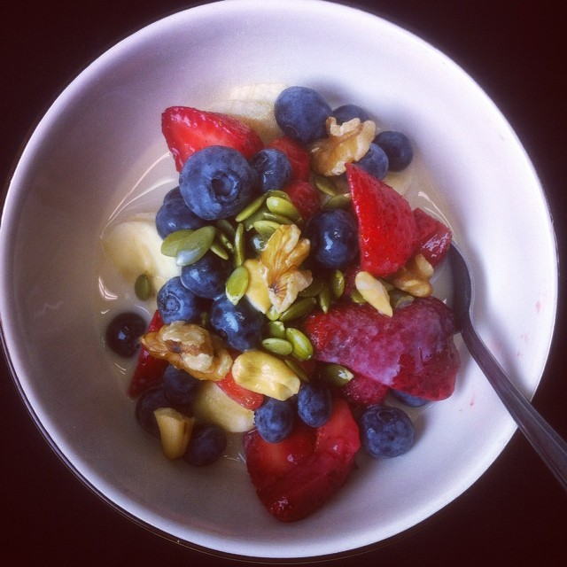 Another delicious breakfast bowl of banana, strawberries, bluebs, cashews, pepitas, and walnuts in almond milk. Mmm :)