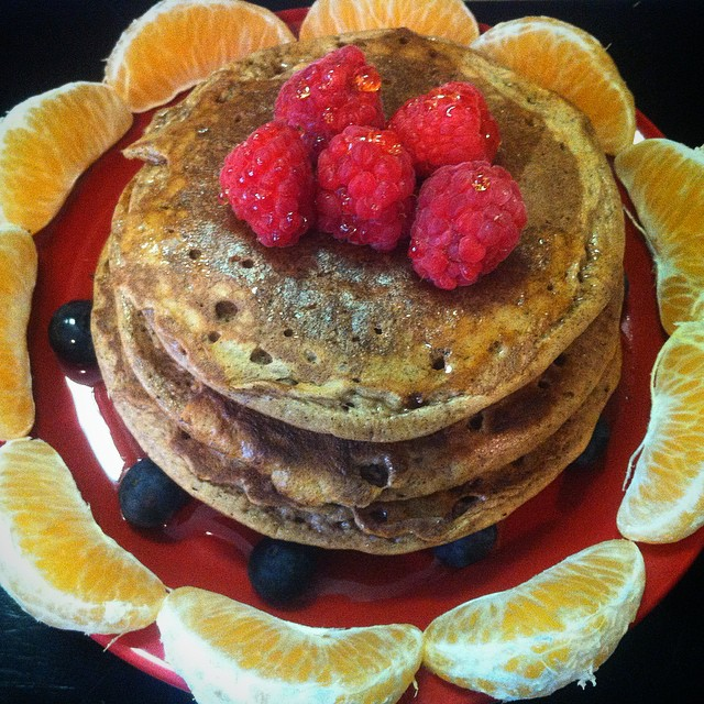 Breakfast for my hubby. Protein pancakes stacked with banana, topped with raspberries, bluebs, clementines, and homemade maple syrup.  High Protein Pancakes  4 eggs 1/4 cup coconut flour  1 tsp baking soda  2 Tbsp protein powder 1 tsp vanilla  1/2 mashed banana Mix everything together and cook on medium.